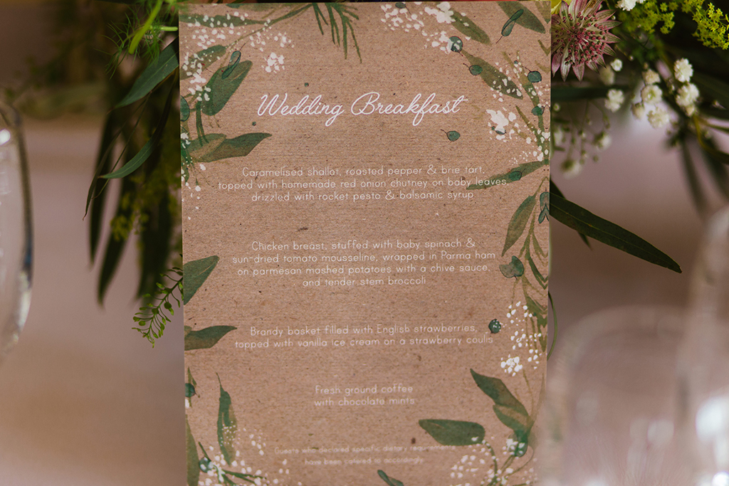 The wedding menus were printed on pretty rustic card at this summer barn wedding in Cheshire