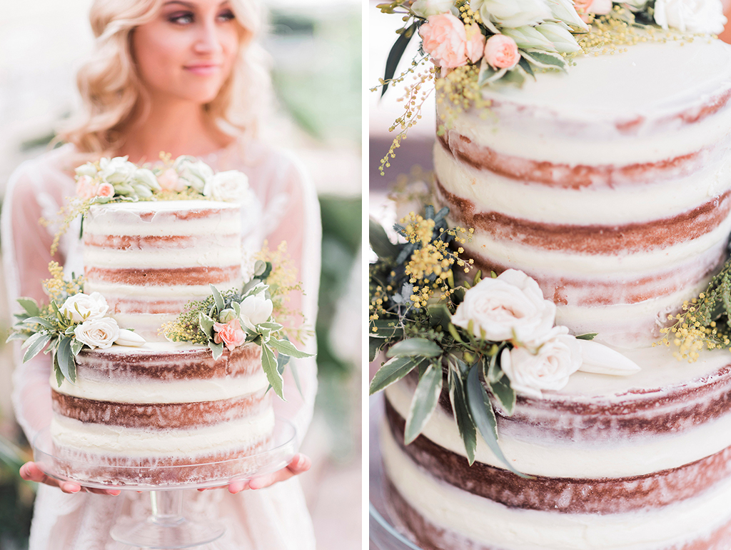 The bride shows off her pretty naked-wedding-cake at her barn wedding in Cheshire