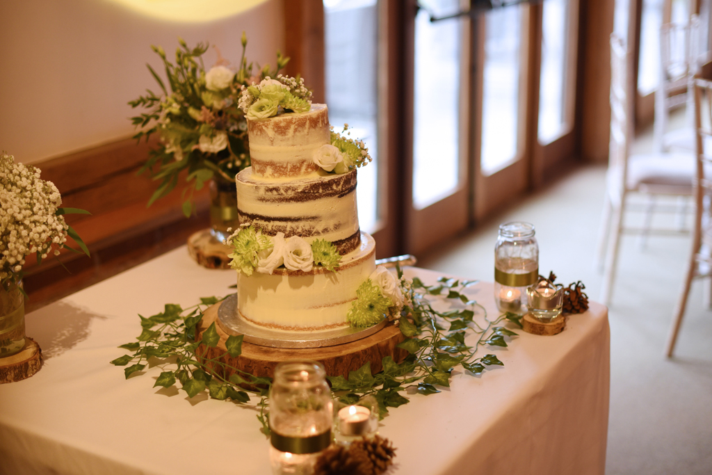 The couple chose a rustic semi naked wedding cake at this barn wedding near Manchester