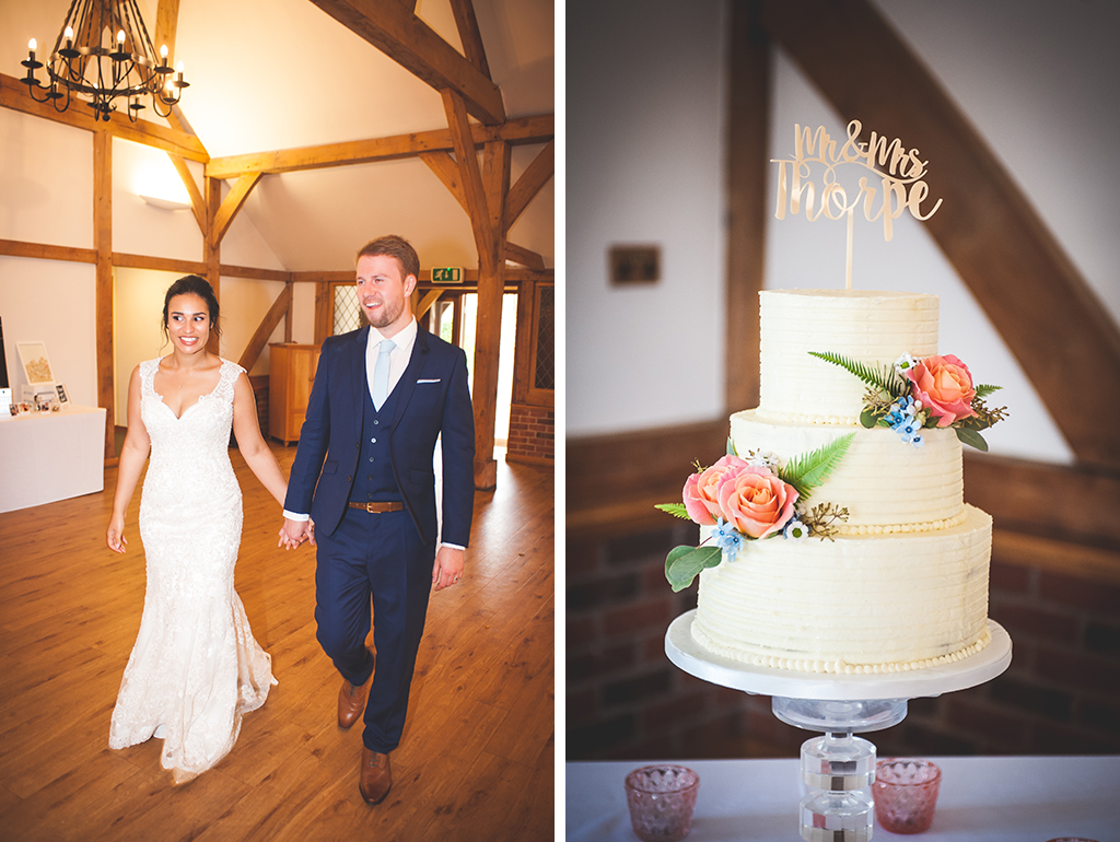 The happy newlyweds make their entrance and the 3 tier wedding cake was semi-naked and decorated with pretty roses and delicate flowers at Sandhole Oak Barn in Cheshire