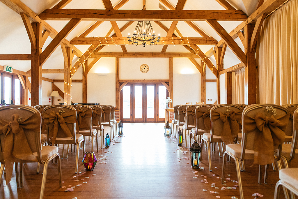 The doors of the Oak Barn open onto the lakeside verandah making it the perfect setting for those balmy wedding days at Sandhole Oak Barn in rural Cheshire