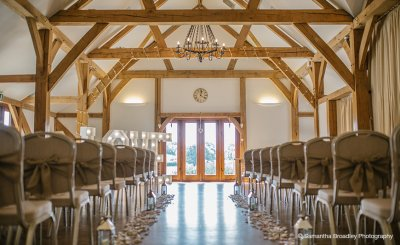 The Oak Barn is set up for the wedding ceremony at Sandhole Oak Barn in the North West