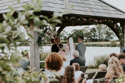 The bride and groom say their vows at their outdoor wedding ceremony at this North West barn wedding