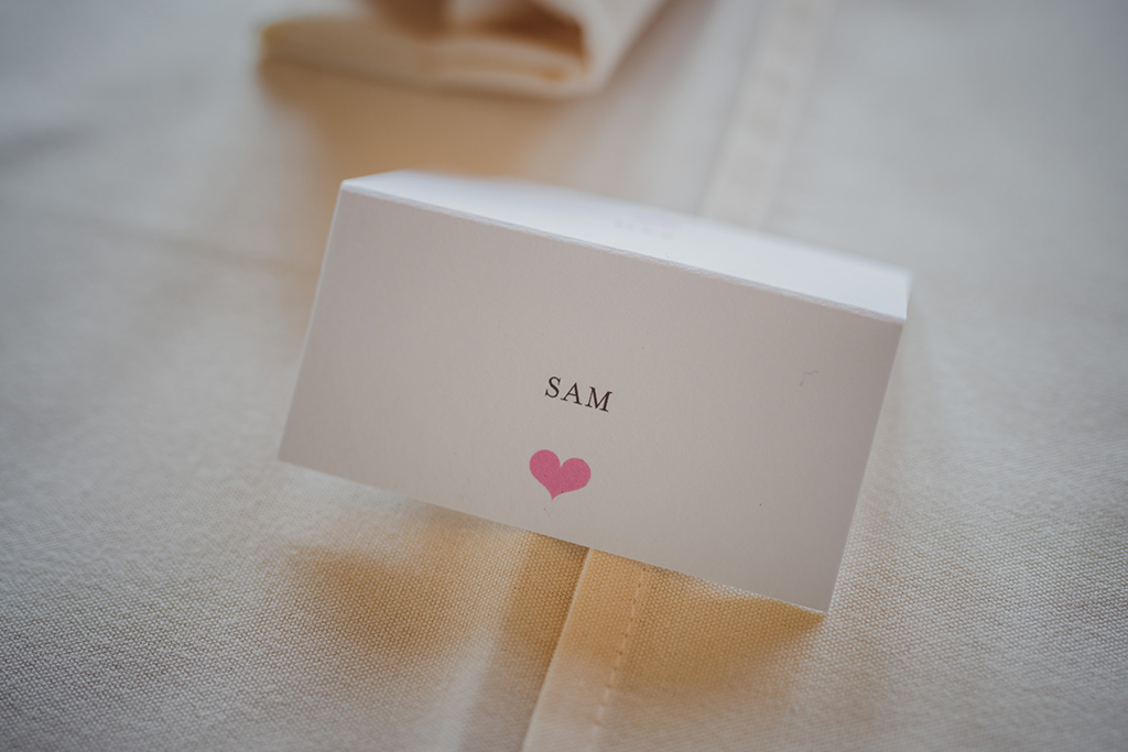The couple chose simple yet elegant handmade made place cards for their barn wedding in Cheshire