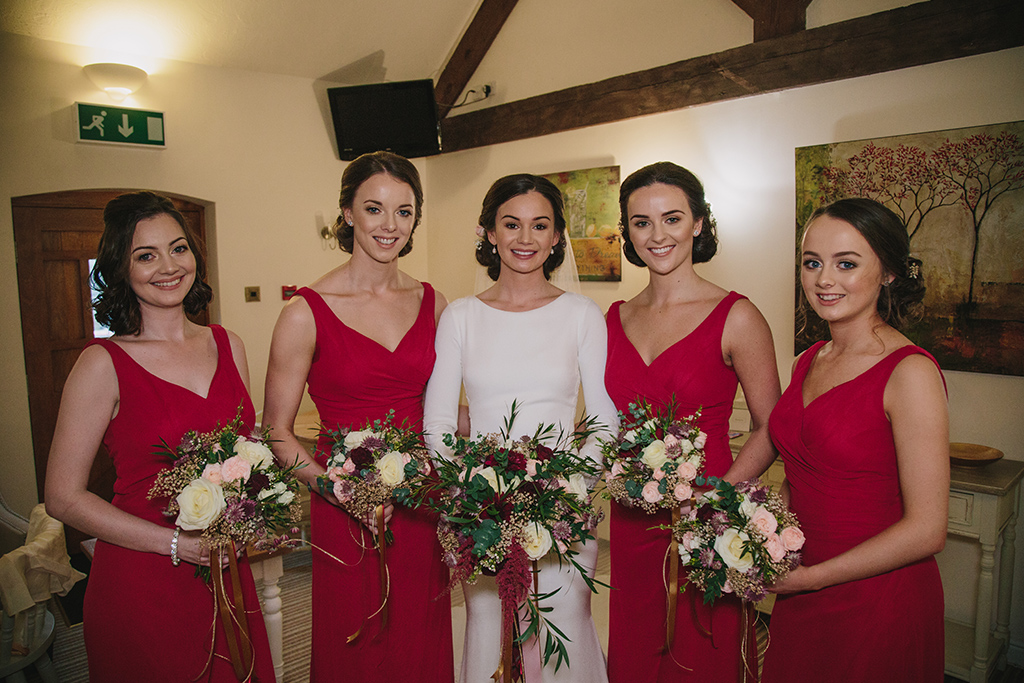 Red bridesmaid dresses are perfect choice for your Valentine wedding at Sandhole Oak Barn in the North West