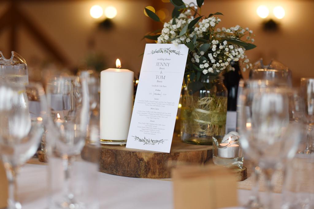 The wedding menus were displayed on rustic wood slices at this barn wedding at Sandhole Oak Barn
