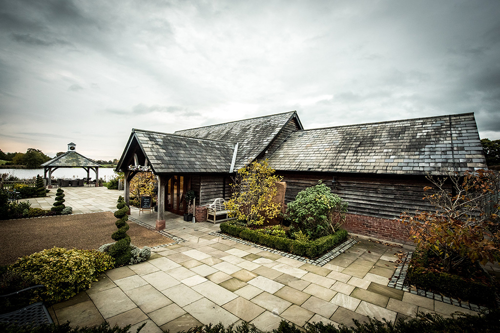 Sandhole Oak Barn in Cheshire is perfect for your autumn wedding with its rustic barn and stunning scenery