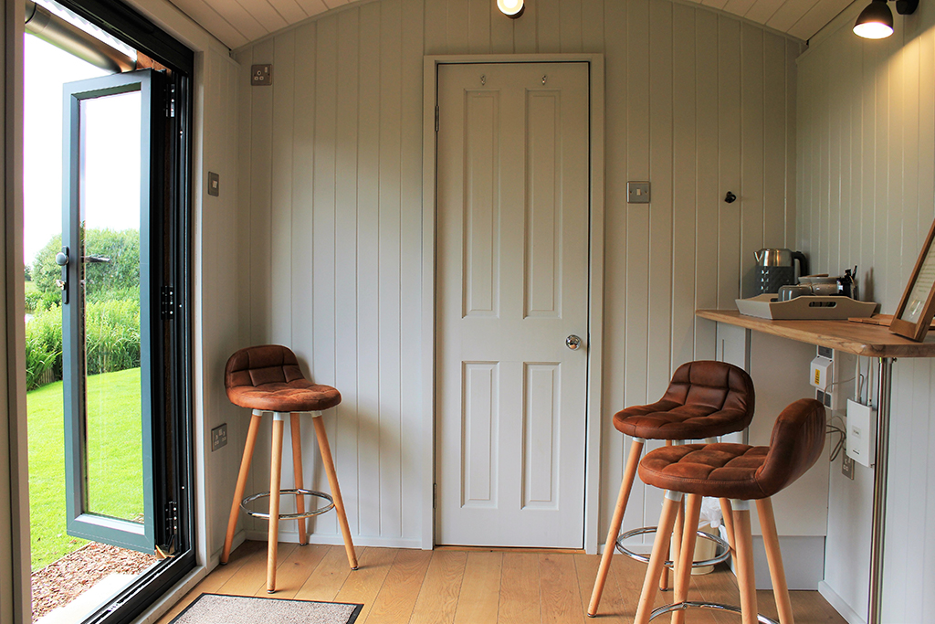 The breakfast bar and stools in the Shepherds hut at Sandhole Oak Barn wedding venue in Cheshire