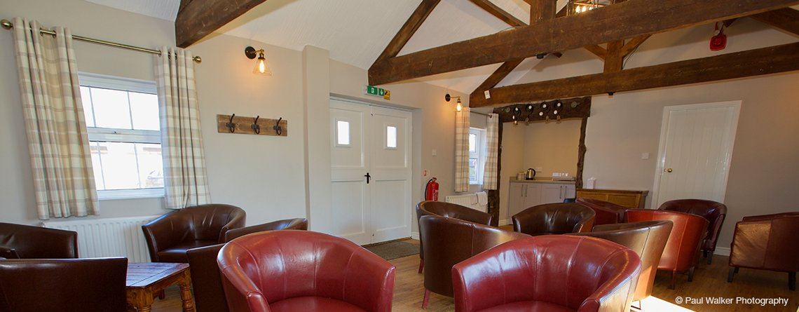 The small barn at Sandhole Oak Barn is perfect place to unwind in between the celebrations at your barn wedding in Cheshire