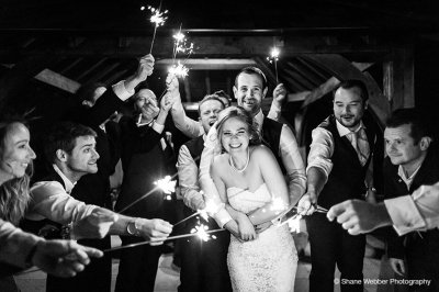 The happy couple enjoy their sparkler finale under the Clock Tower at Sandhole Oak Barn near Manchester