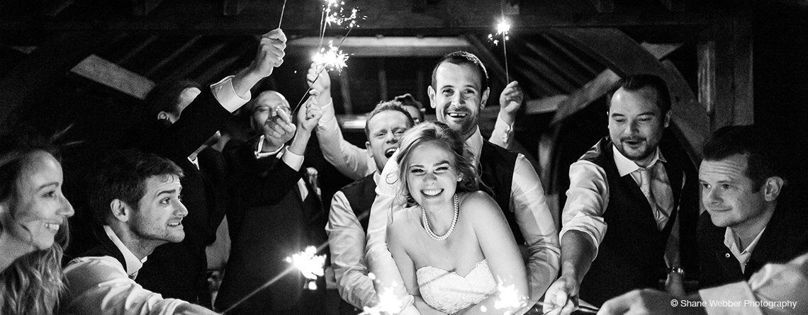 The bride and groom enjoy the sparkler finale under the Clock Tower at this wedding barn at Sandhole Oak Barn