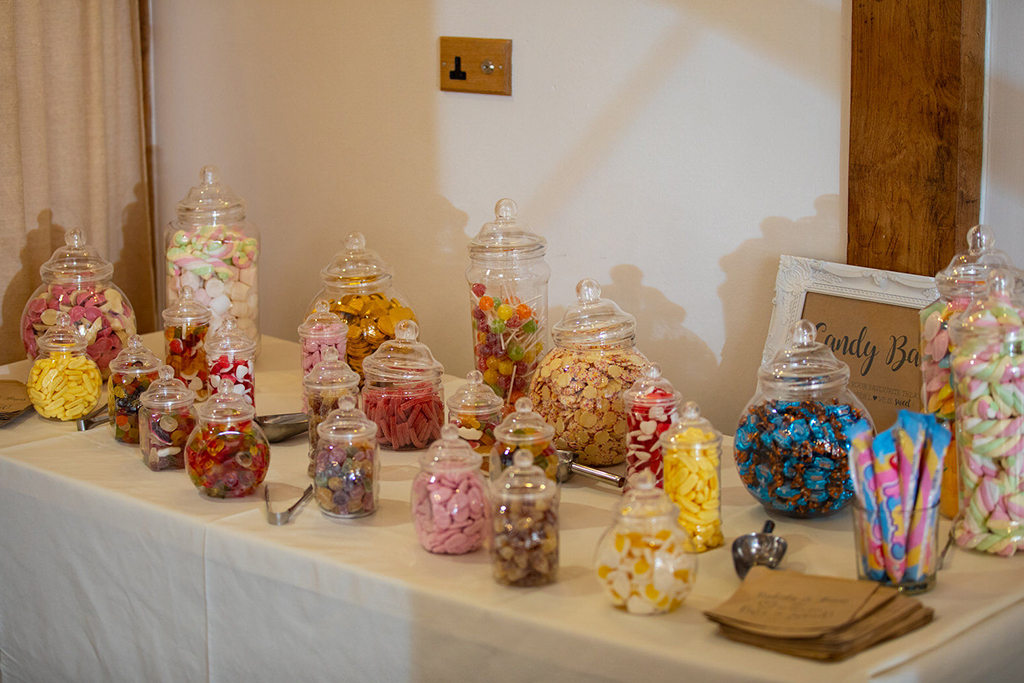 The couple had a sweet table for their wedding guests to enjoy at their barn wedding in Cheshire
