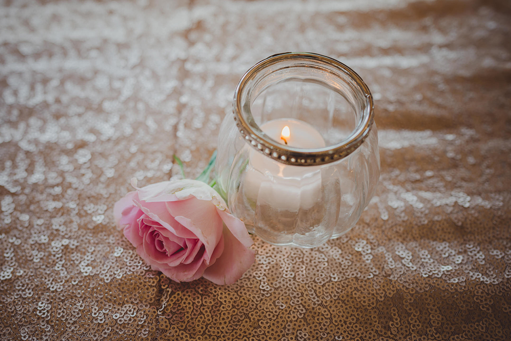 Tealights in pretty glass jars were used to decorate this barn wedding at Sandhole Oak Barn