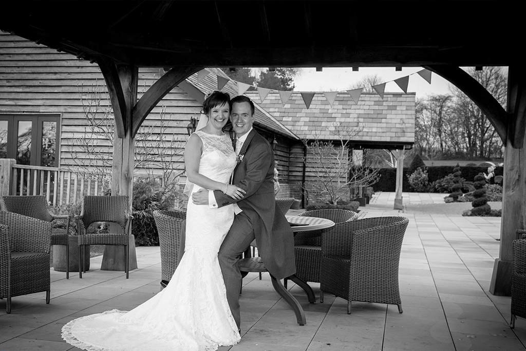 The happy couple take a moment to pose for photos at Sandhole Oak Barn