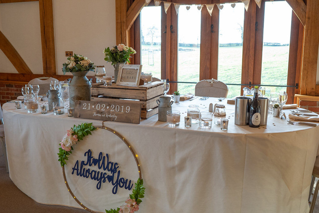 The top table was decorated with rustic items at Sandhole Oak Barn