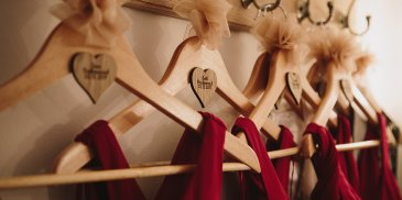 Red bridesmaid dresses are a perfect choice for a valentine wedding at Sandhole Oak Barn