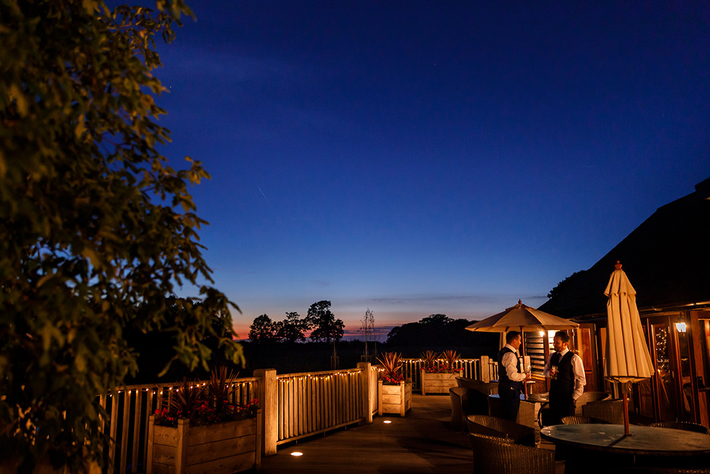 The verandah at Sandhole Oak Barn is the perfect place to watch the sunset on a warm evening in Cheshire
