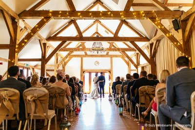The happy couple say their vows at their wedding ceremony at Sandhole Oak Barn near Manchester