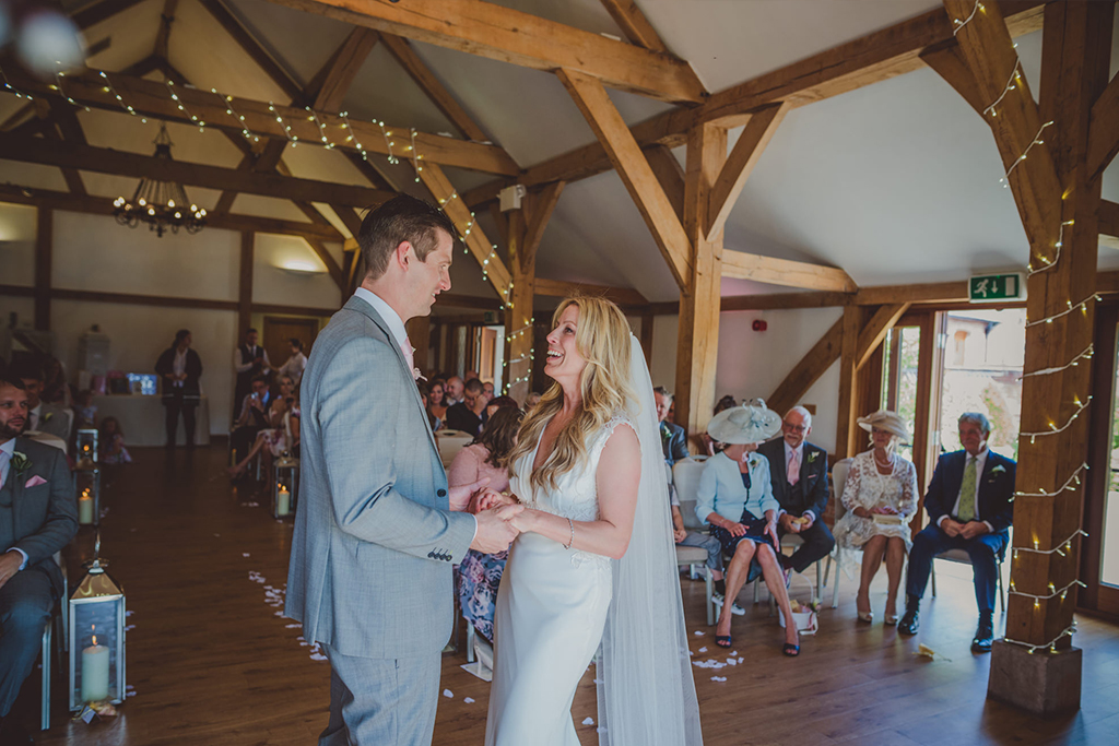 The happy couple say their vows at their wedding ceremony at Sandhole Oak Barn