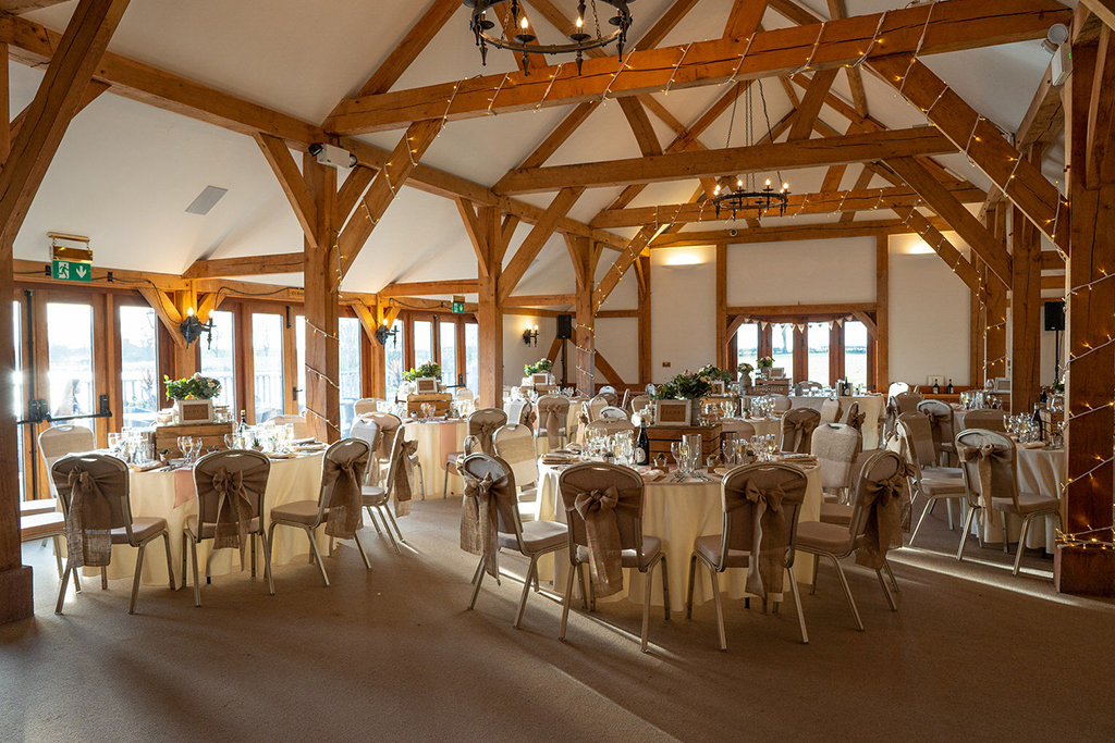 The oak barn was set up for the wedding breakfast at Sandhole Oak Barn in Cheshire