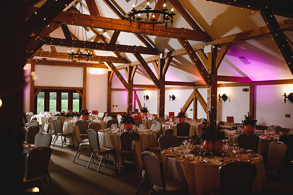 The Oak Barn was lit with pretty fairy lights along the beams and coloured lights lit up the walls