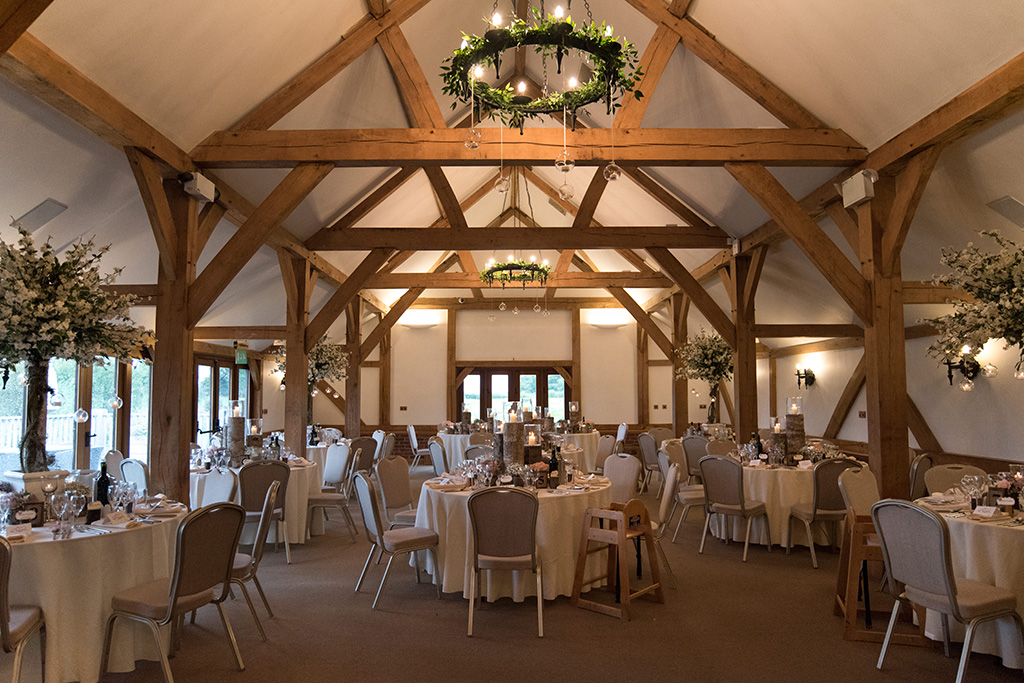 The oak barn is set up for the wedding breakfast at Sandhole Oak Barn in Cheshire