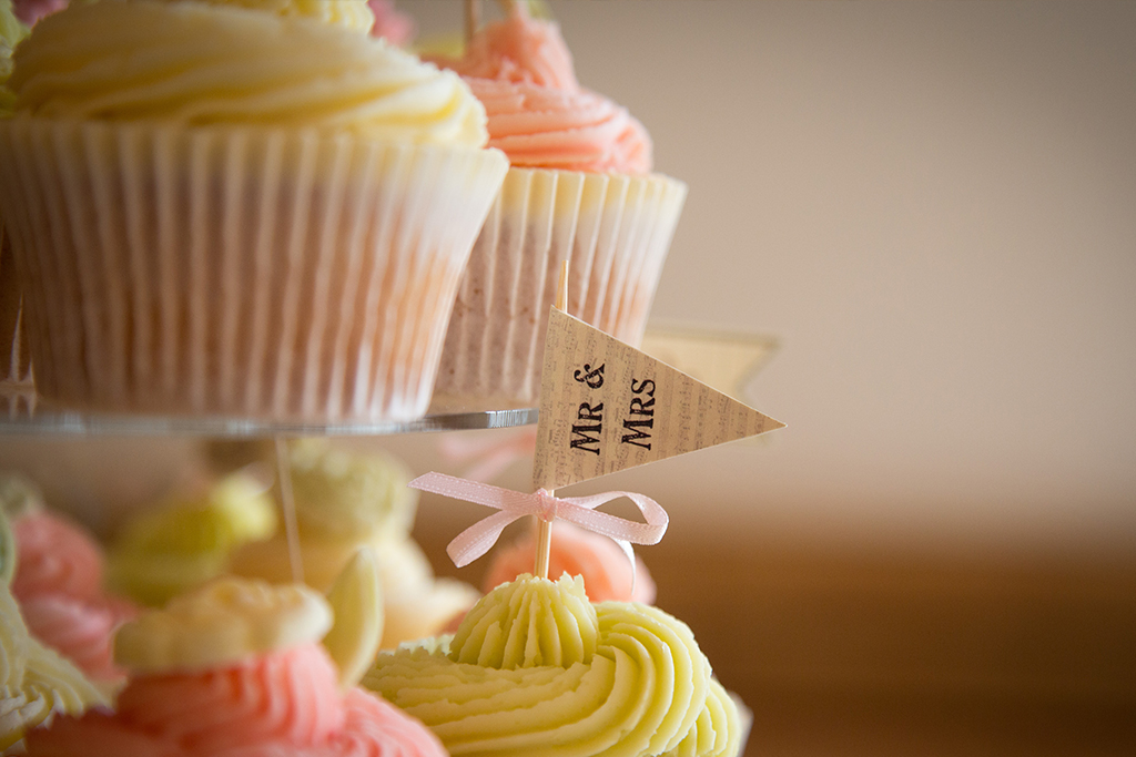 The wedding cake was made up of perfectly pretty pastel iced cupcakes at Sandhole Oak Barn