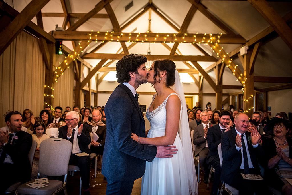 Rustic barn venues can be simply but effectively decorated with fairy lights around the beams for your autumn wedding