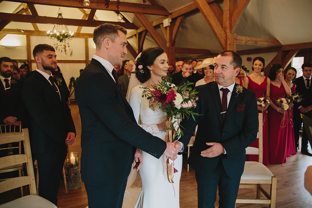 The bride's father gives his seal of approval at this beautiful barn wedding at Sandhole Oak Barn in the North West