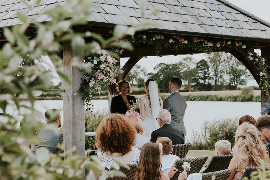 An outdoor wedding ceremony is the perfect option for your spring wedding at Sandhole Oak Barn