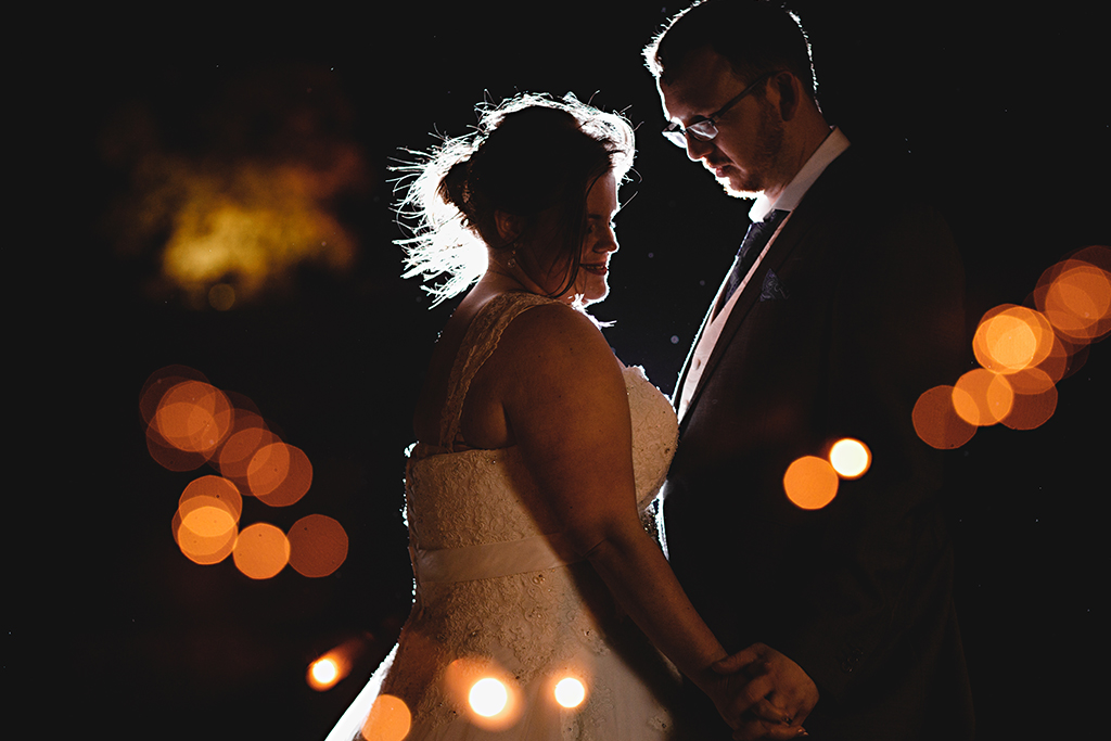 The bride and groom steal a moment at their wedding evening at Sandhole Oak Barn