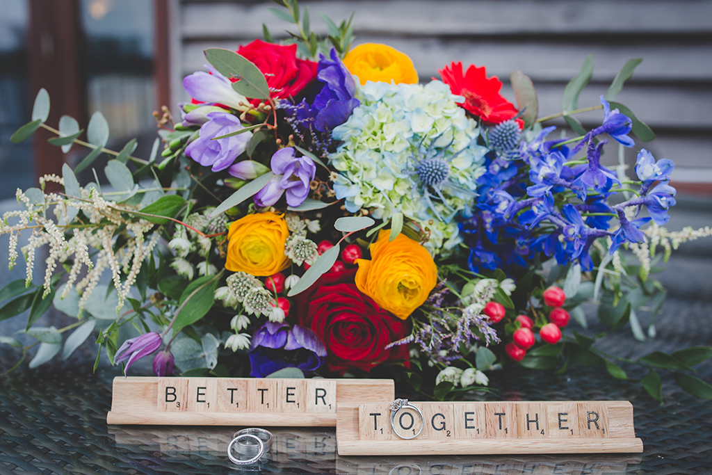The wedding flowers were a stunning mix of beautifully bright coloured blooms and lush foliage at this barn wedding in Cheshire