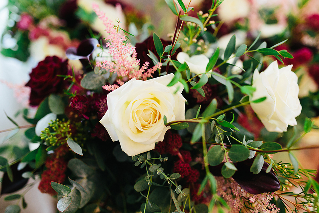 The bride's wedding flowers consisted of hues of red and ivory for a sophisticated and classy look