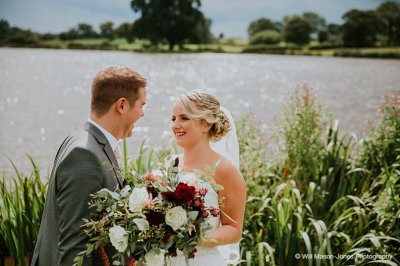 The tables were decorated with beautiful blush pink flowers and pretty garlands adorn the chandeliers and beams at this exclusive-wedding-venue-near Manchester