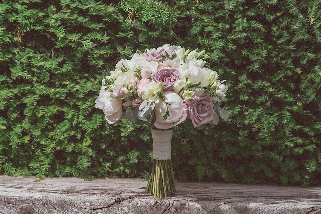 The bride's wedding bouquet featured beautiful wedding flowers including pink roses and peonies