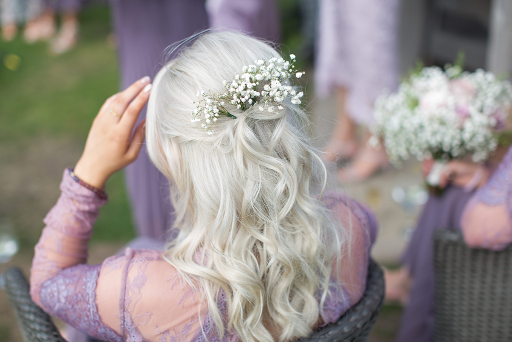 Small bunches of gypsophila make the perfect spring wedding hair accessory for your barn wedding at Sandhole Oak Barn