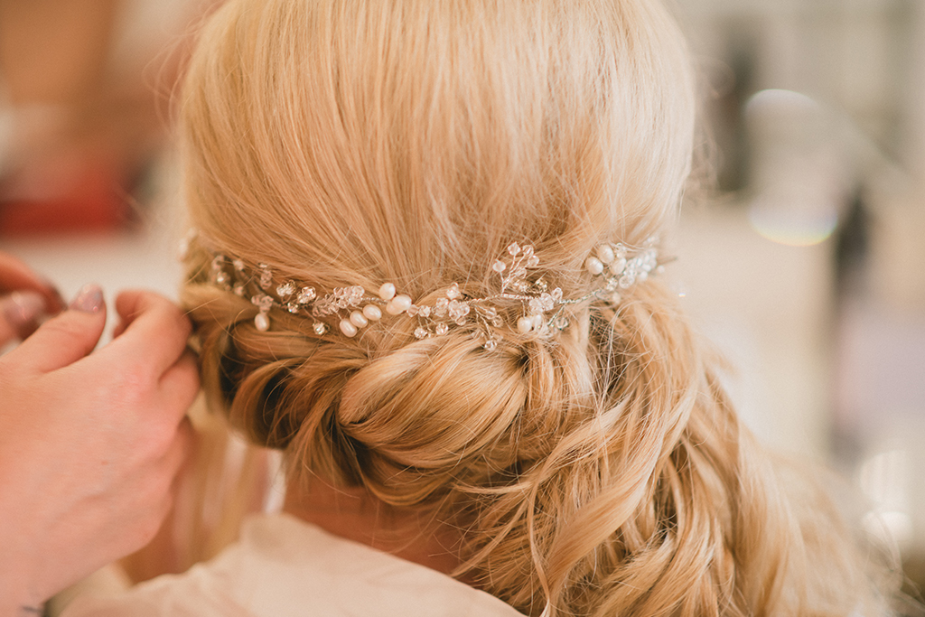 The bride enjoys her bridal preparations as she has her wedding hair done in the stylish wedding accommodation