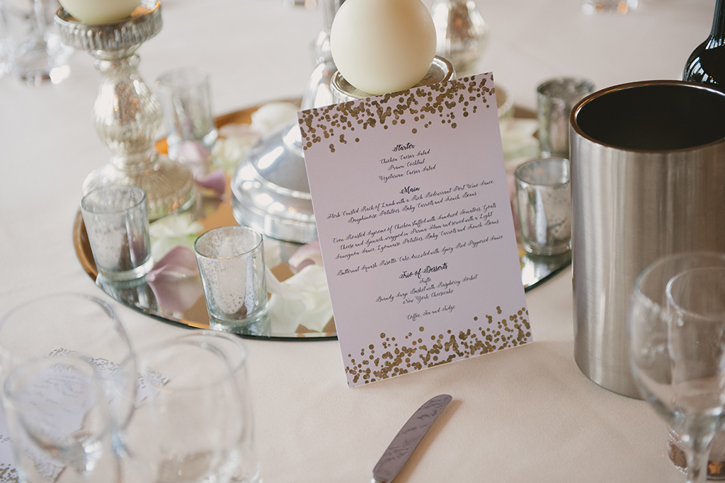 The wedding breakfast menu was displayed on a white card decorated with gold foil confetti – wedding ideas