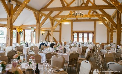 The Oak Barn is set up for the wedding reception at this wedding barn in Cheshire