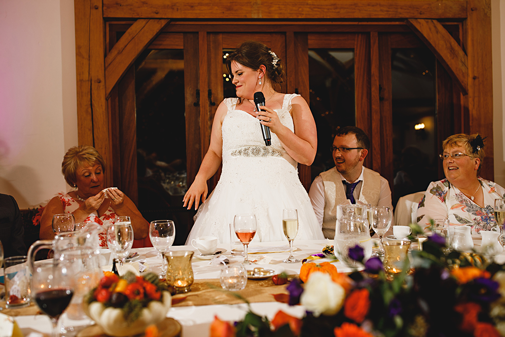 The bride makes a speech at her wedding at Sandhole Oak Barn in Cheshire