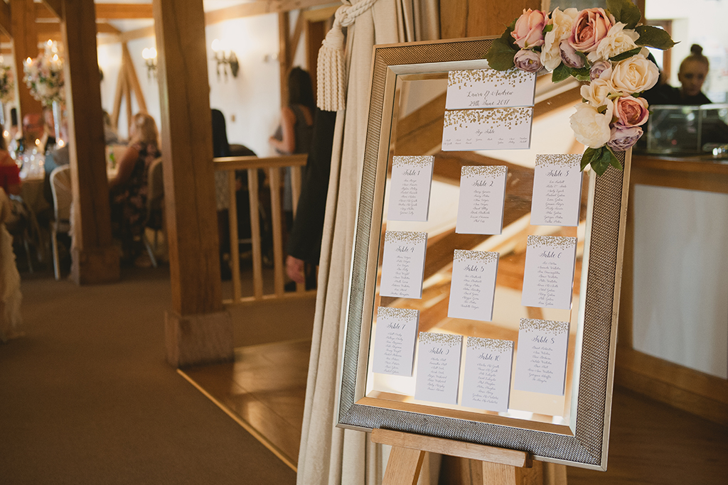 The couple's stylish wedding table plan was presented on a mirror directing wedding guests to their seats