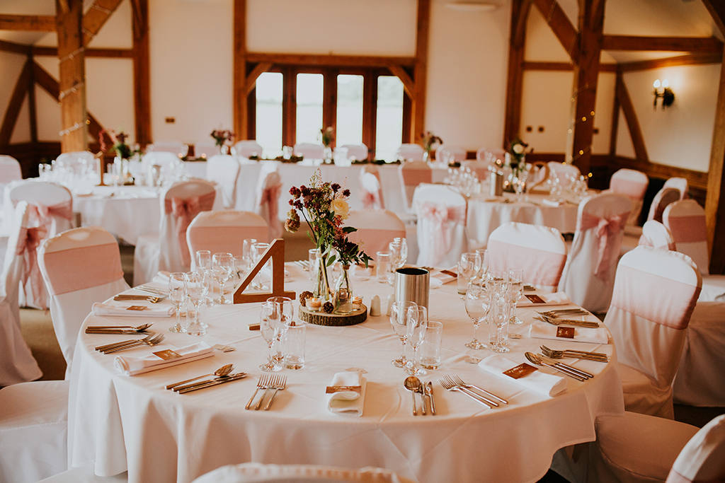 The oak barn with views over the lake and beyond looked beautiful set up for the wedding breakfast