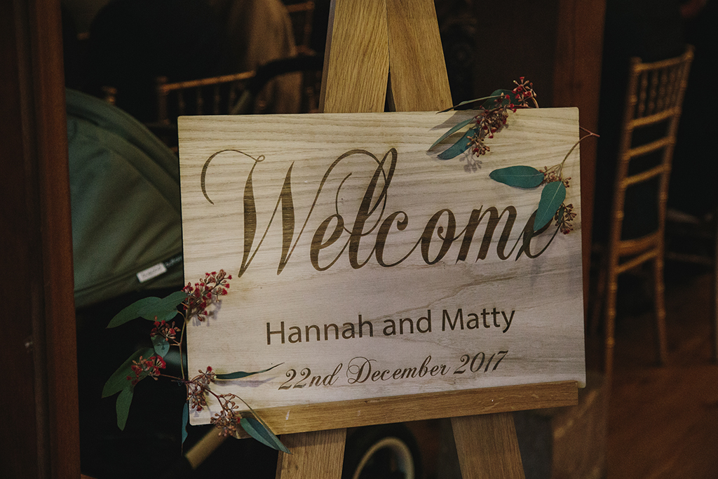 An inviting rustic wooden sign welcomed guests at this barn venue in Cheshire
