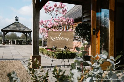 A pretty wedding sign welcomes guests to the wedding at this rural wedding venue in Cheshire