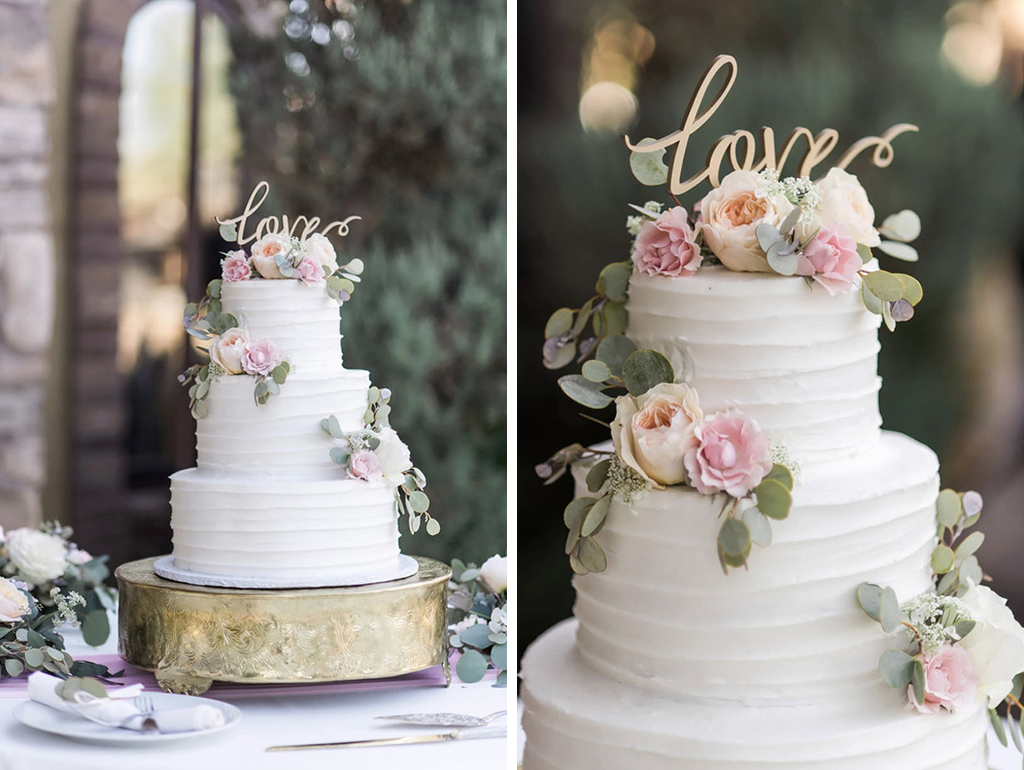 This elegant three-tiered white iced wedding cake is perfect for a summer wedding